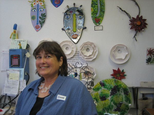 Artist Dianne Van de Carr, with a selection of her glass fusion pieces.