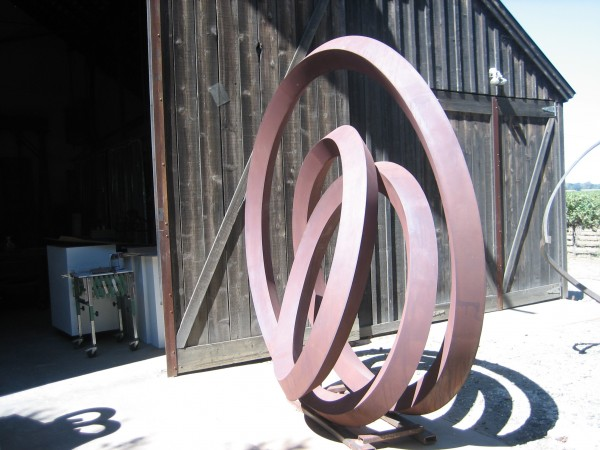 Roger Berry, sculpture rests in front of his studio,  2014.