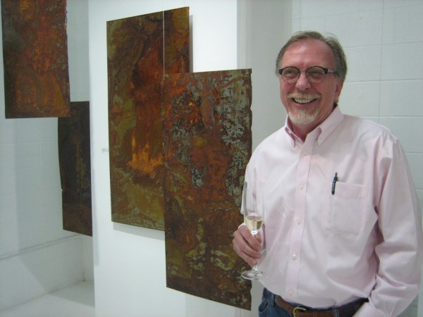 Artist William Ishmael with work he created.